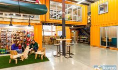 Kurgo's new dog-friendly office boasts bright orange shipping containers used as meeting and stock-rooms.
