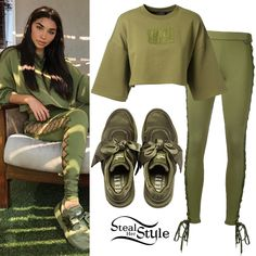 Chantel Jeffries instagrammed a picture yesterday wearing a Cropped Crew Neck Tee ($60.00), Lace-Up Leggings ($140.00) and Satin Bow Sneakers ($160.00) all from Fenty Puma by Rihanna.