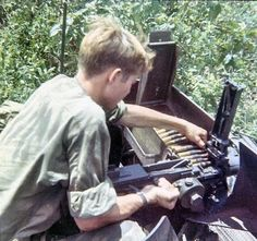 Reloading the .50 caliber machine gun of an M113 Armored Personnel Carrier.