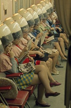 1940s-1950s going to the beauty shop and sitting under a dome hair dryer. Home bonnet dryers became popular in the late 1950s. Thank heaven for today's hand-held dryer!