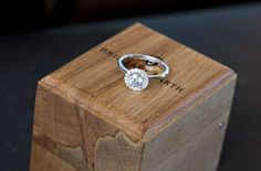 Halo with a plain band. You always see a diamond band but this is striking--perhaps just cause it's different.