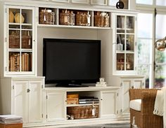 #pottery barn - I'd love to have shelving like this, I also love the natural wood of the wicker baskets