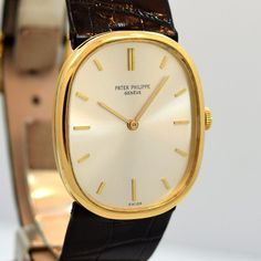 18K Yellow Gold Vintage Patek Philippe Ellipse Ref. 3548 with Original Silver Dial with Applied Yellow Gold Stick/Bar Markers with Patek Philippe Alligator Strap and 18k Yellow Gold Buckle. Triple Sig