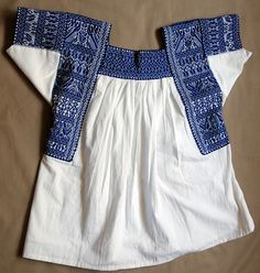 Just can't beat blue and white!    Nahua Blouse Tehuacan, via Flickr.