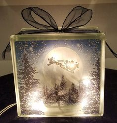 This DISNEY Santa Mickey glass block light makes the perfect nightlight or decoration for that special Disney fan!!!! This light measures approximately 8x8x3 inches and includes a 20 bulb strand of standard clear lights, a moonlit snowy background with Pluto pulling Santa Mickeys Sleigh,