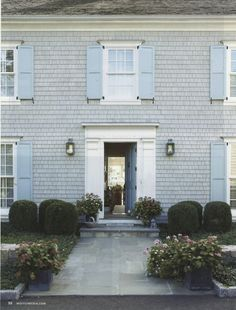 gray house with pale blue shutters and white trim