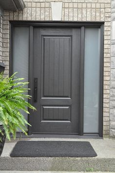This woodgrain fiberglass door system and frosted glass give this home a simple, modern/rustic feel.  www.doorwayinc.ca