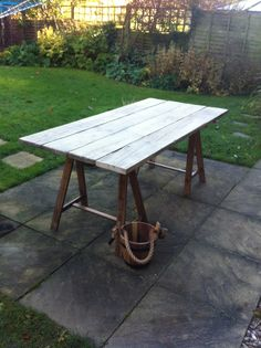 This table is intended to recreate the feel of the late medieval-Tudor-Stuart period. The table top is made from old scaffold boards sanded down and the trestles are Ikea table legs repainted to resemble wood. The bucket is really a cut down Ikea plant pot.