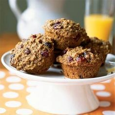 With four whole grains and three dried fruits, these muffins are a great way to get a variety of antioxidants and fiber. Wheat germ is a good source of vitamin E. Look for untoasted wheat germ in the organic food section of the supermarket. Adding boiling water to the batter and allowing it to sit for 15 minutes before baking allows the hearty oats, wheat germ, and bran to soak up the liquid for a more tender muffin.