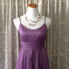 """Lavender pleated dress with pockets David's Bridal pretty purple dress with empire pleated wast and pleated skirt. Cute pockets too. Zipper down back. Measures approx. 35"""" from shoulder to hem, 17"""" across chest, 14"""" across empire waist. 100% cotton Davids Bridal Dresses"""