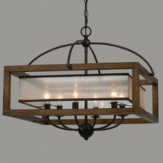 """A rustic wood frame with Bronze hardware, contrasts a sheer champagne square shade with contemporary sophistication for this mission rustic style chandelier. 6x40 watts candelabra. (20""""Hx24""""W) 6' chain, 8' wire. 5"""" bronze canopy."""
