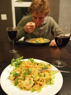 Spagetti Squash Pad Thai [spaghetti squash, bok choy, carrots, garlic, veggie broth, peanut butter, rice wine vinegar, soy sauce, red chili pepper, peanuts, green onions, cilantro, lime wedges]