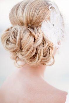 Updo with Feathers - California Weddings: http://www.pinterest.com/fresnoweddings/