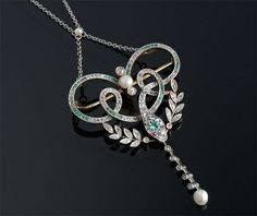 Edwardian diamond, emeralds, and pearl snake motif