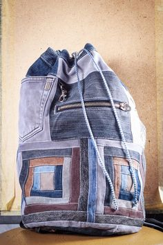* * * bRuckSack SHOP - UPCYCLED JEANS BACKPACKS * * * Welcome to my shop! My name is Tatiana and I make unique patchwork jeans backpacks. Check out my work!  * * *  This is a unique patchwork bag of dark blue, light blue and brown denim with smooth geometric square pattern.  It is made out of used jeans. It has round bottom, stiched back, a big pocket and a small one inside, also a zipped pocket outside.  Its unisex - suits everyone! This bag will surely contain all your stuff for school or…