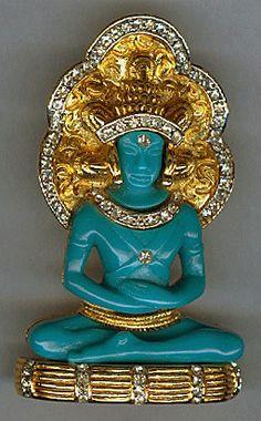 HATTIE CARNEGIE Turquoise Lucite & Rhinestone Seated Buddha Pin