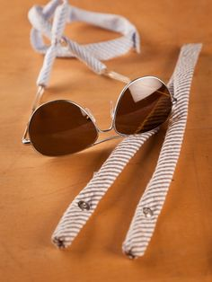 Seersucker Sunglass Straps by CottonSnaps - what a unique idea!