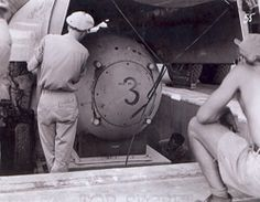 A pumpkin bomb (Fat Man test unit) being raised from the pit into the bomb bay of a for bombing practice during the weeks before the attack on Nagasaki. Nagasaki, Nuclear Bomb, Tinian Island, First Atomic Bomb, Hiroshima Bombing, Day Of Silence, Enola Gay, Manhattan Project