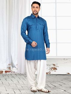 An adorable Cotton Silk fabric Light Blue Pathani Suit. It is paired with contrast White Voile fabric bottom. This plain Pathani is decorated with fancy buttons. Pathani Suit Men, Pathani Kurta, Cotton Silk Fabric, Fancy Buttons, Occasion Wear, Festival Wear, Wedding Suits, Mens Suits, Dapper