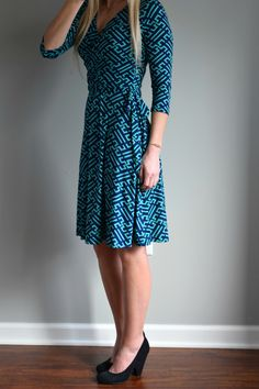 I own and love this dress 41 Hawthorn Renesme Graphic Print Faux Wrap Dress because the neck line is flattering, but not too low,. The thick belt on the wrap dress lays nicely (thin belts tend to show off my belly) and the length is perfect.  It's my favorite Stitch Fix item. J.wood