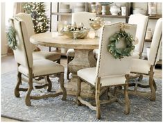 From Ballard Designs -  I like the chairs.  I think this will look good with the stone table that Sal is going to be designing and creating for the room.
