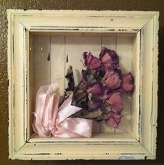 Thrift shop shadow box upcycled by removing the original art and painting the back interior. Dried flowers and a bow from a memorial service were placed inside and now it's a treasured memory box.