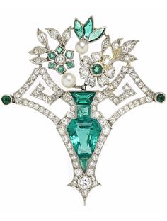 A diamond, emerald, pearl and glass brooch, floral vase motif, with emerald, glass and diamond set frame and pearl accents; estimated total diamond weight: 1.25 carats; mounted in platinum; length: 1 5/8in.