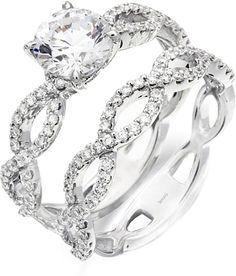 Simon G Twist Diamond Wedding Band: This diamond wedding band by Simon G features round brilliant cut diamonds pave set along a twist shank.