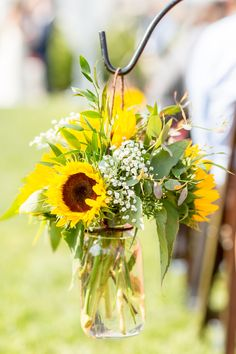 Wedding Ceremony Aisle Arrangements. Sunflowers and Babies Breath in Mason Jar.  Waller Weddings.