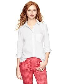 Tailored shirt What about a white blouse for Claudia? She would still pop without being colorful.  ??