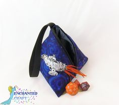 """This little bag has plenty of room to carry your essentials as you unite with the other Browncoats!Whether you need a small bag for just carrying your phone, ID, and a bit of money or need a cool bag to hold small items that like to escape in your purse or tote, this bag fits the bill!The unusual 4 sided bag is fully lined in dusty blue satin moire and closes with a 6"""" zipper. The outside is made of beautiful blue fabric with swirling galaxy clouds"""