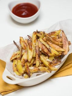 Crispy Baked Fries Recipe- These fries are very flavorful, crispy, to the point of hearing a crunch when you bite into one. They are totally kids friendly, my boys asked for seconds.