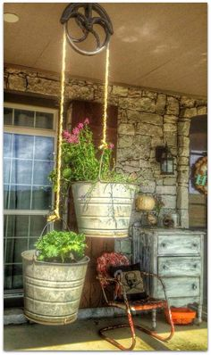 ***NO LINK*** Old pulley, old buckets and flowers