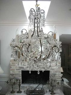 I love the fullness, the lushness, the branching of this gorgeous light fixture. It would surely set the tone for an evening of splendor.
