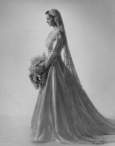 Satin Wedding Dresses Bride in vintage wedding gown with lace veil Mrs. Harry Havemeyer Webb (formerly Kate de Forest Jennings) wearing her satin wedding dress with wide berth of lace. Stock Photo Date Photographed:May 1947 Vintage Wedding Photos, Vintage Bridal, Wedding Pictures, Vintage Weddings, Vintage Wedding Gowns, Silver Weddings, Country Weddings, Lace Weddings, Wedding Attire