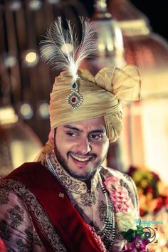 the three colors matches perfectly. If you are bright add red to your groom outfit. Silver sherwani, golden pagdi and red dupatta looks adorable together.