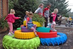 What a great idea for a kids play area in the garden. Painted tires. #tires #upcycle