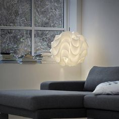 The Illuminating Experiences Le Klint 172 Pendant is an example of modern origami. The White plastic shade is is pressed with the desired shape and then hand-folded into its 3-dimensional form. First created in 1971, the Le Klint 172 Pendant is a retro design by Poul Christiansen.