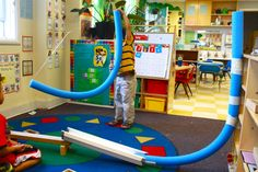 We built marble runs with pool noodles! Hang from the celling to make a launcher, or attach to a shelf to shoot it out on the floor