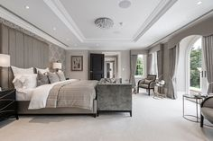 Elegant classic contemporary master bedroom suite in luxurious Surrey mansion, in subtle grey tones with full height upholstered headboard designed by www.aji.co.uk