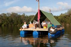 """minus the whole """"living in a tent thing"""" (although that's still cool), I like this homemade pontoon boat."""