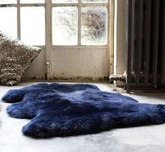 "Luxurious Midnight Blue Sheepskin Rug | Introducing #Hygge – our favourite new excuse to snuggle under a chunky knit with a cup of cocoa. Pronounced ""hooga"", this Danish trend is all about embracing cosiness and enjoying the good things in life surrounded by your favourite people. That definitely sounds like something we can get on board with."