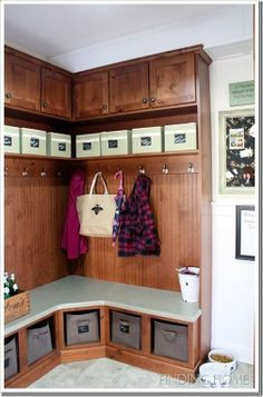 corner mud room bench - I like the sides, beadboard on back wall, cabinets on top. I dont like the angle in the corner of the bench. Probably wouldnt do the storage bins under the cabinets.