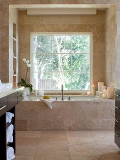 Create a clean, serene space by placing aromatherapy candles of various heights around the bathtub, and placing fresh, out-of-the-dryer warm towels off to the side. Incorporate organic tones and natural elements for an authentic spa atmosphere.