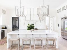 One of our all-time favorite trends is without a doubt the all-white kitchen.