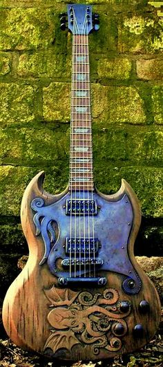 The Cthulhu SG (featuring Seymour Duncan Invaders and a custom tentacled scratchplate by Hutchinson Guitar Concepts) --- https://www.pinterest.com/lardyfatboy/