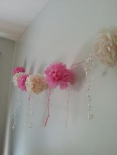 Handmade made to order garland pom poms These delightful Pom poms are the perfect decoration to brighten up any room/space to be admired by everyone. They are perfect for childrens birthdays weddings or any special occasions. These pom poms are all handmade as shown in the pictures above  These pom poms are sent Pre- assembled and attached to the ribbon but they are not in bloom Full instructions are included each pom pom will take around 4-5mins to make. They are centre wrapped and folded…