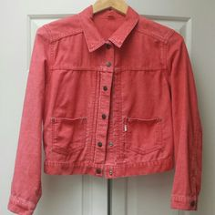 Levi's courderoy cropped jacket Super adorable light jacket with snaps. One side of the tag has fallen off. 1st photo is most accurate color, more coral than pink Levi's Jackets & Coats