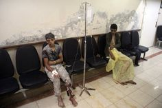 Boys await treatment at a makeshift hospital following strikes and shelling on the rebel-held city, in Idlib, Syria. (Omar Haj Kadour / AFP / Getty Images)