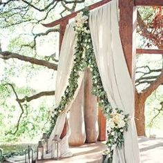 arbor with draping and lanterns